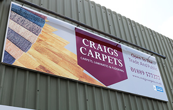 Craigs carpets sign outside discount warehouse